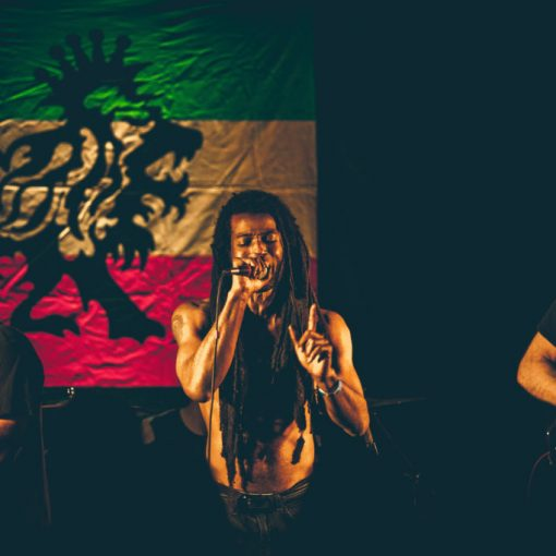 DredIDread image of band with lead singer singing