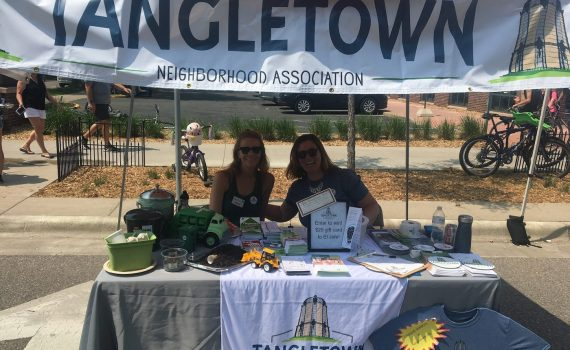 Image of two people at Tangletown table
