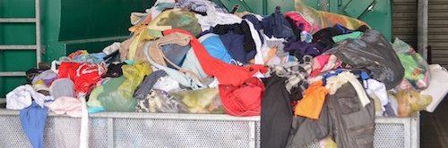 Photo of dumpster full of clothing
